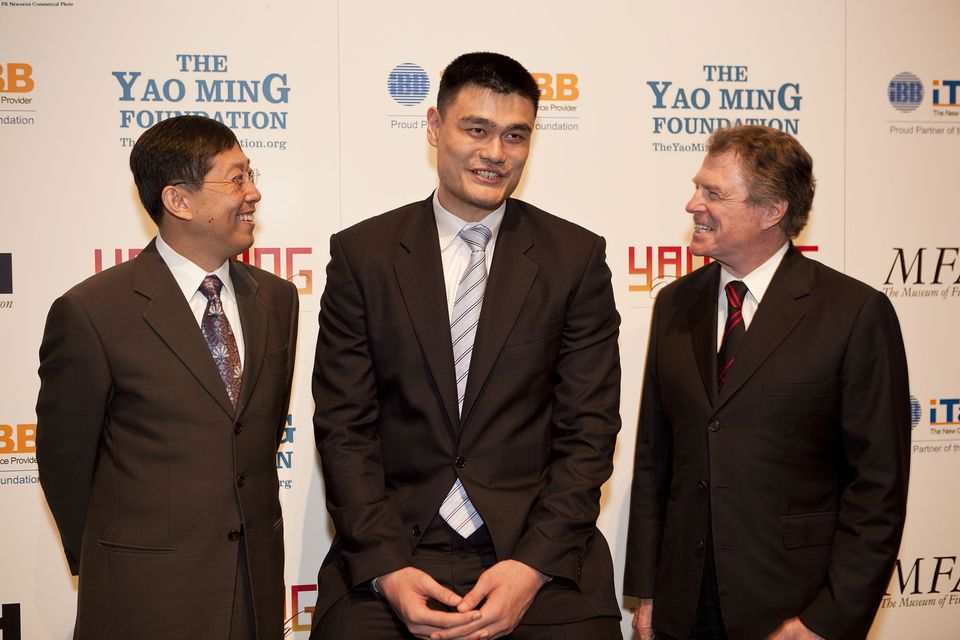 Jack Zhao, CEO of iTALK BB Global Communications (left,) Yao Ming, and Dr. Peter Marzio, MFAH director in 2010 during an annoucement about the Houston Rockets partnership with the Museum of Fine Arts in Houston.