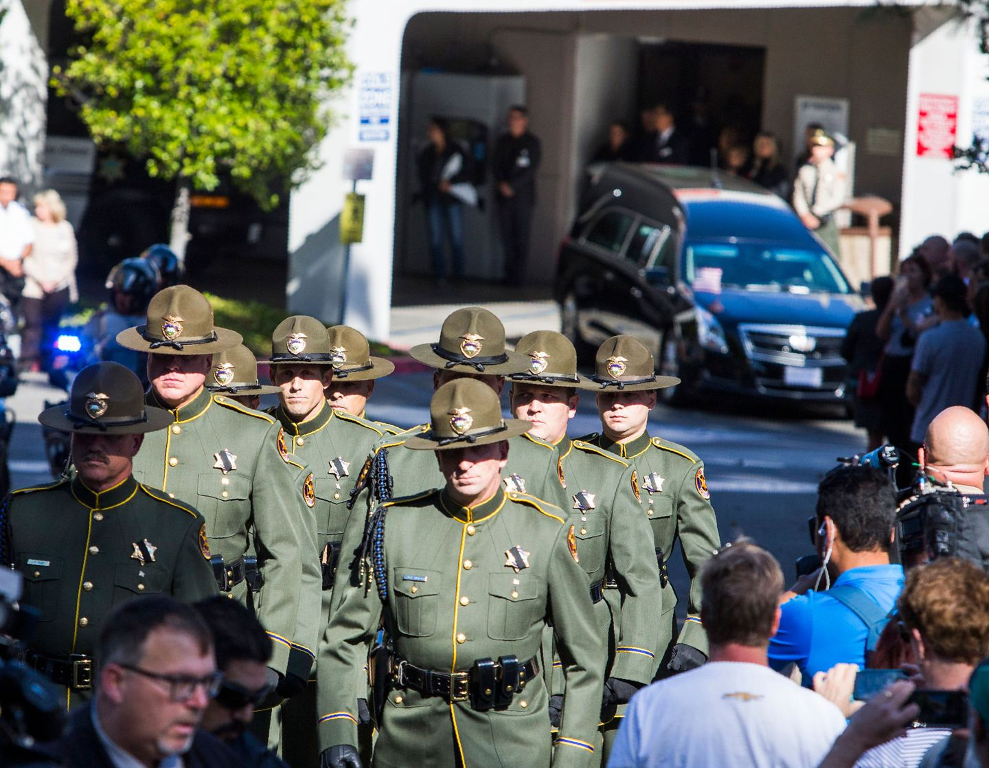 Ventura Sheriff Officers opened the way for a motorcade, carrying Ventura Country sheriff Sgt. Ron Helus.