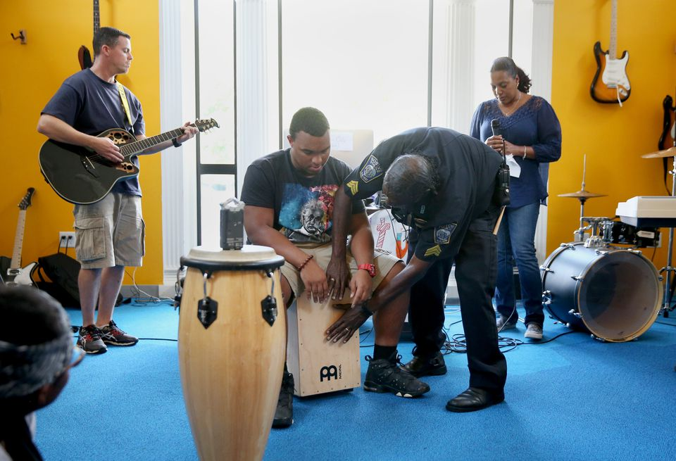 Center: Carlos Barbosa, 17, of Dorchester, and Boston Police Department Sergeant John Burns come up with a beat during a Code Listen musical session.