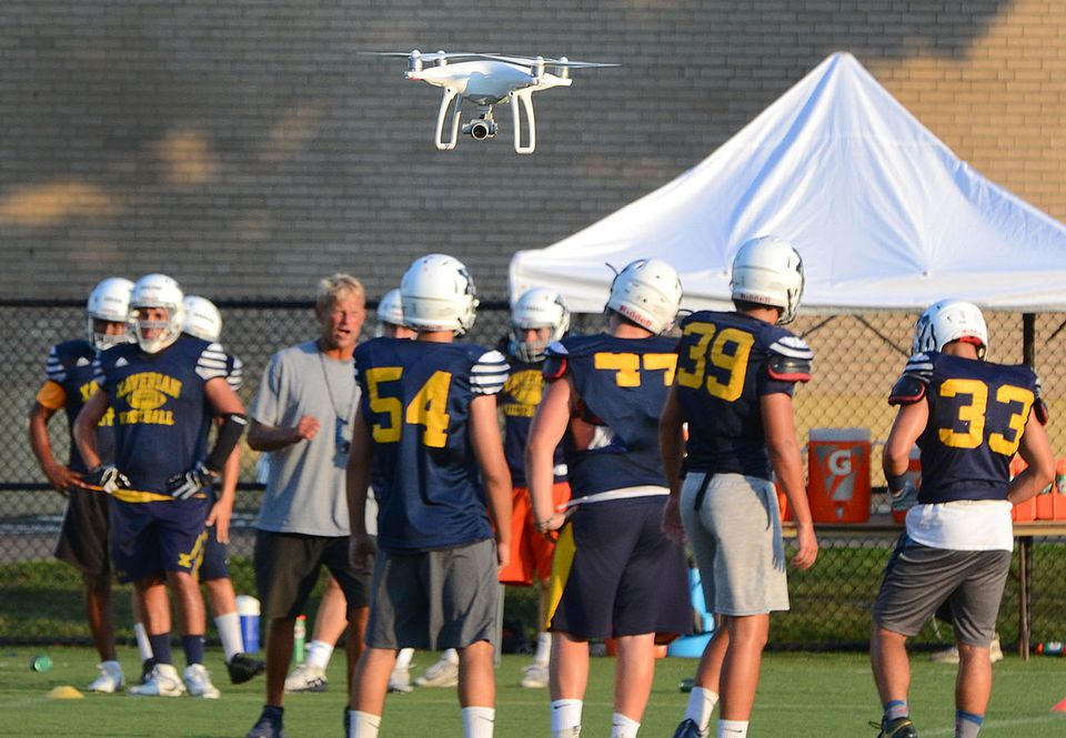 A drone hovers over Xaverian's practice, taking video.