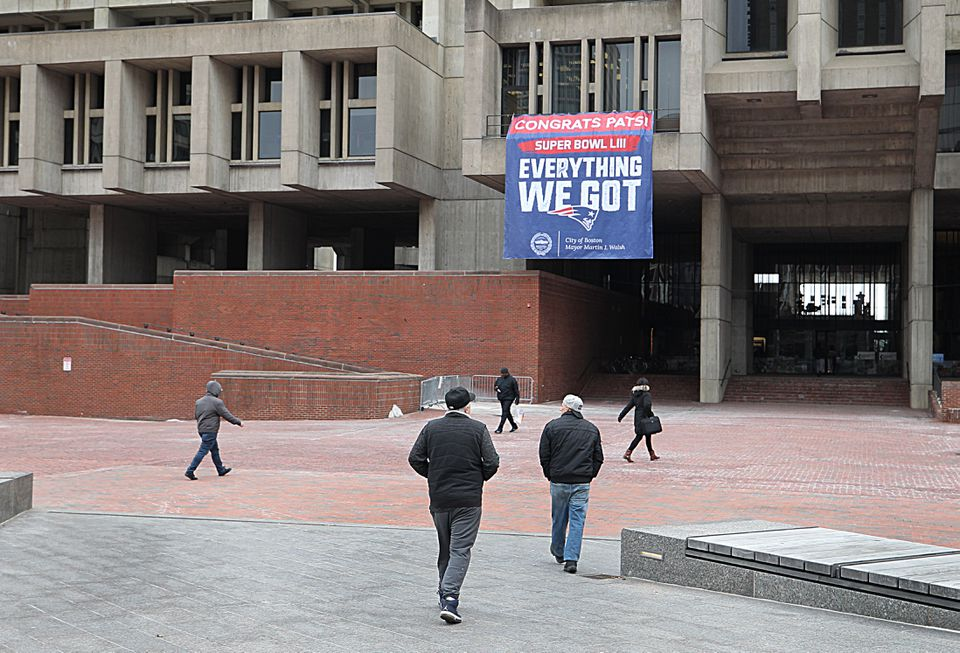 A Patriots banner on City Hall.