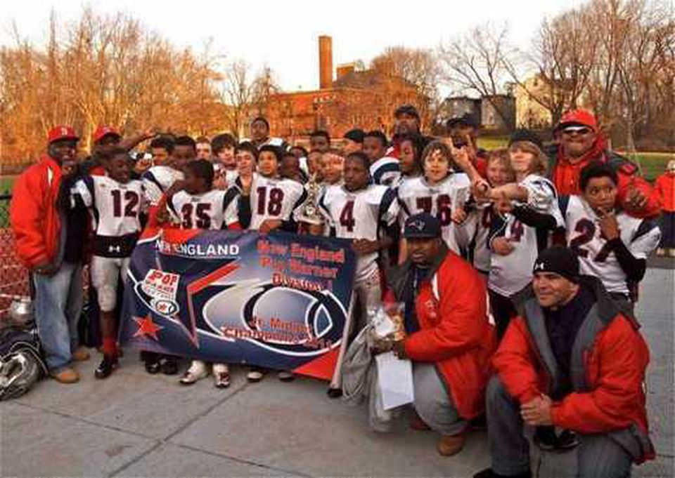 Brookline-Jamaica Plain Patriots Junior Midget players, ages 11 to 13, and coaches celebrated their regional championship win.
