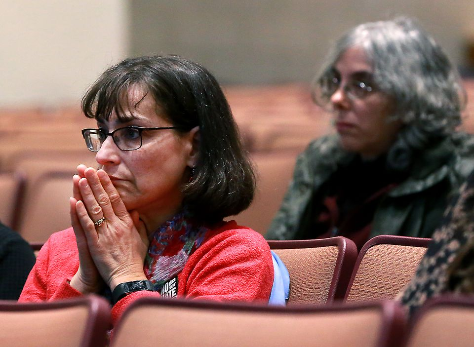 Anne Schwartz listened during a town select meeting Tuesday on racist graffiti found at Reading Memorial High School and at other locations.