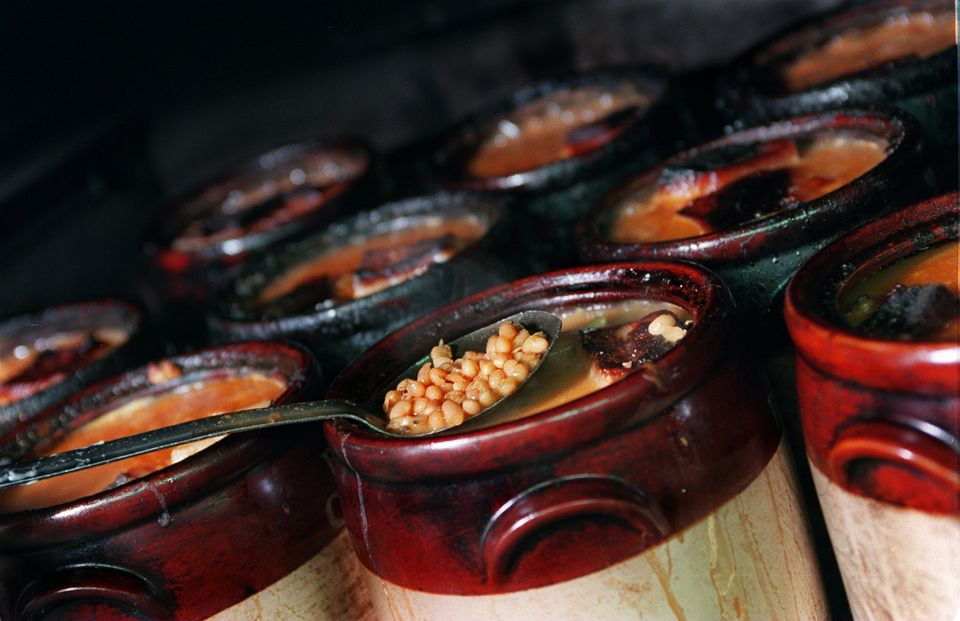 Ceramic pots filled of baked beans, molasses, salt pork and mustard baked for five and half hours at Durgin-Park .