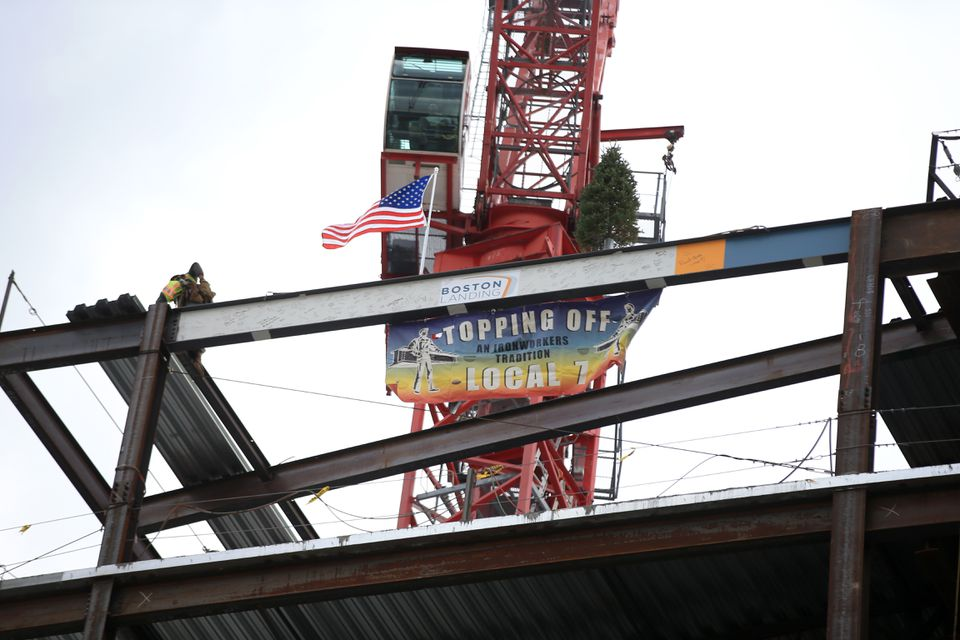 The final two steel beams were placed at the topping-off ceremony at the Boston Bruins' new practicie facility Warrior Ice Arena at Boston Landing Development.