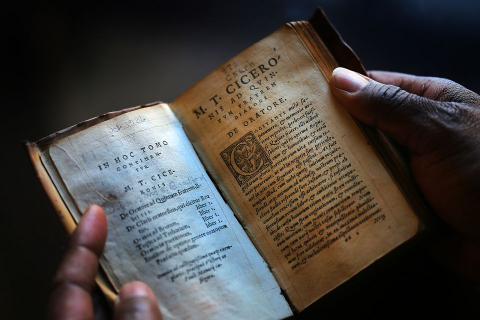 Albie Johnson held William Bradford's copy of the writings of Cicero, printed in 1546, which he carried with him on the Mayflower.