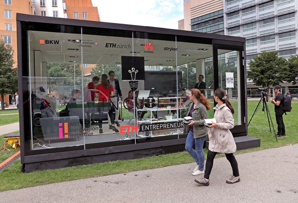 Five MIT students shut themselves inside a transparent glass box Thursday.