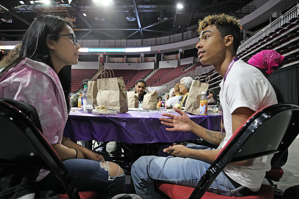 Yoyo Chen (left) spoke with Anthony Pereira-Pomales at the MLK Scholars event Friday.