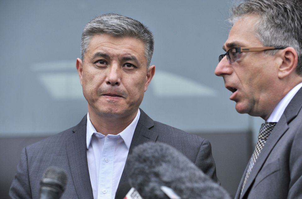 Murat Kadyrbayev (left), father of Dias Kadyrbayev, spoke to reporters through interpreter Alexander Tetradze after his son was sentenced to six years in prison.