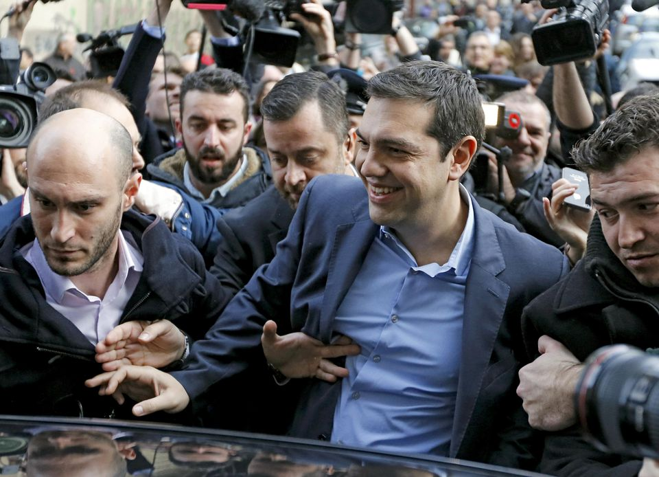 Head of radical leftist Syriza party Alexis Tsipras arrives at a polling station in Athens Sunday.