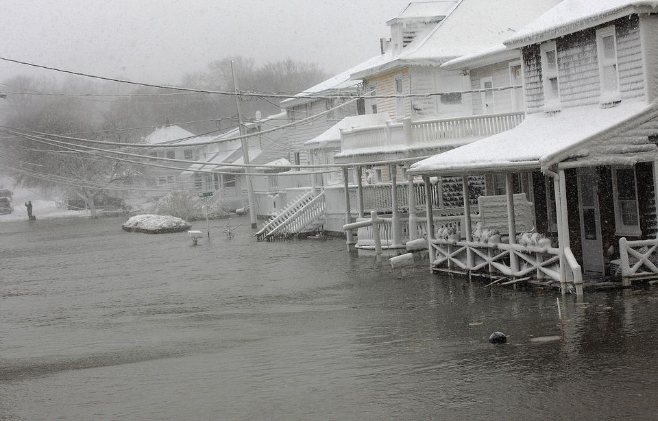Homes on Turner Road in Scituate were circled by water from the ocean during last week's blizzard.