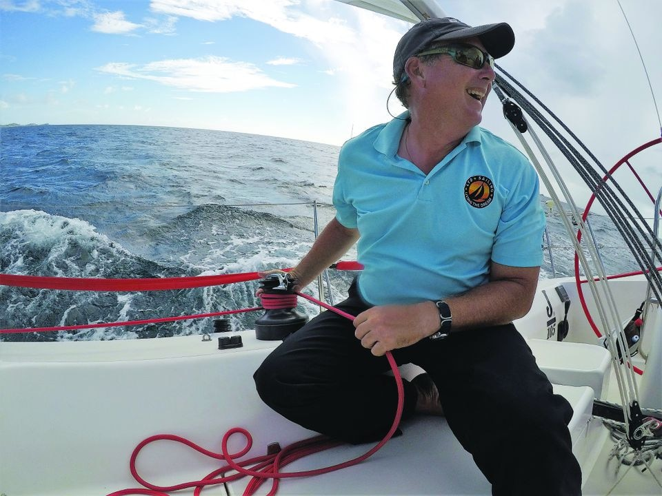 "Chris Rundlett, an owner and founder of LTD Sailing, sails ""Dogsmile,"" a J/105. The fast, stable boat is good for teaching."
