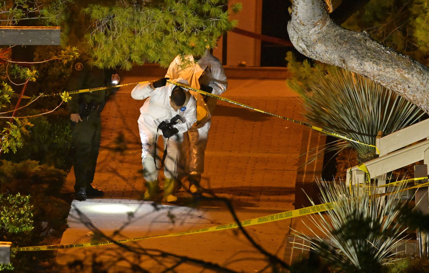 A forensics team worked the scene in Thousand Oaks, Calif. on Thursday.