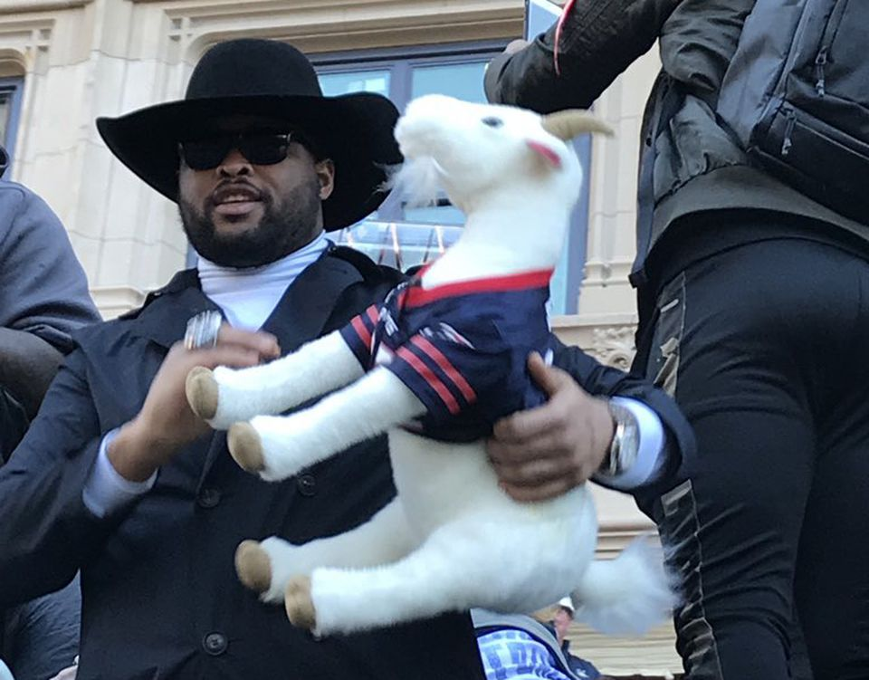 Patriots players passed around a stuffed goat tossed to them by Michael Brody and his wife, Sheri. Here, Marcus Cannon poses with the plush toy.
