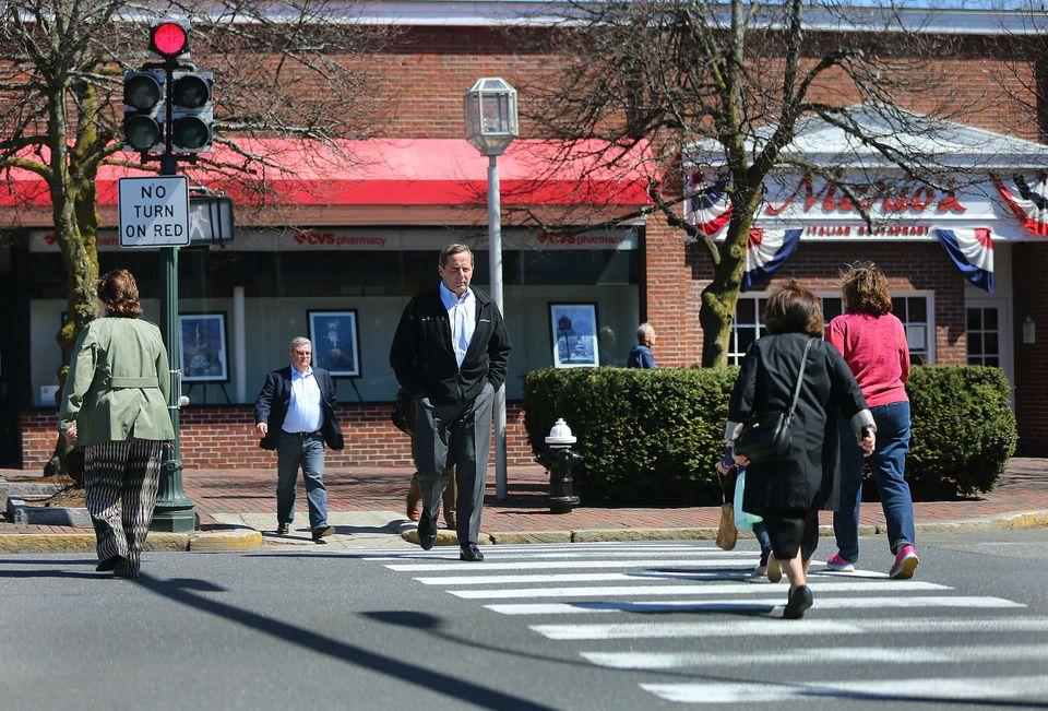 Pedestrians crossed Massachusetts Avenue in Lexington.
