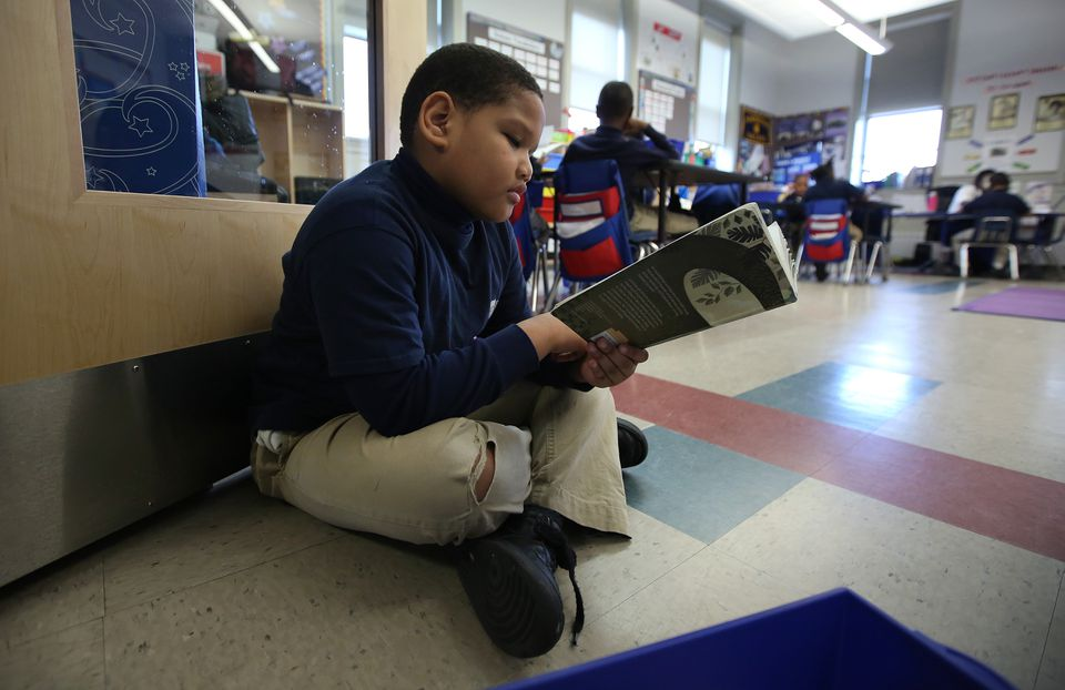 Second-grader Giovany Fernandes was comfortable during independent reading at the Brooke Charter School in Mattapan.