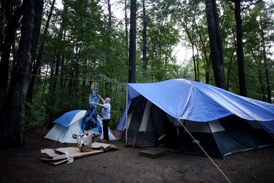 Navy veteran Norman Franks spent four months in a cramped tent in a campsite on the grounds of Hanscom Air Force Base. (Craig F. Walker/Globe Staff)