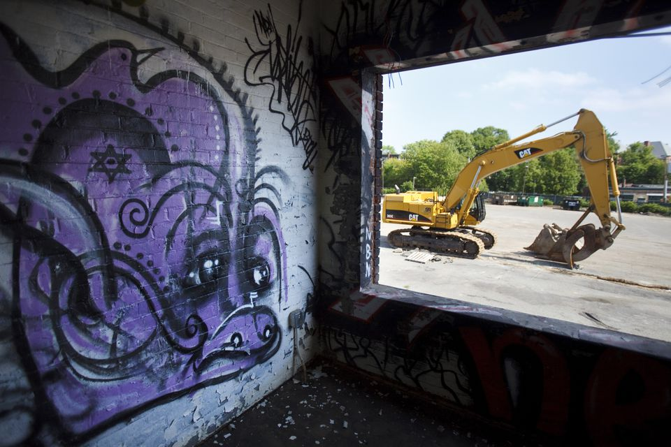 The Bartlett Yard bus depot, which has been a playground for graffiti artists for the past few years, is finally being demolished.