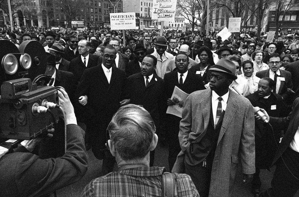 Dr. Martin Luther King Jr. led a civil rights march down Charles Street in Boston on April 23, 1965.