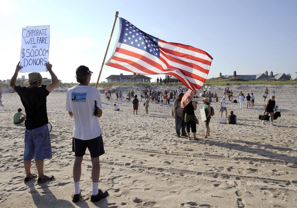 Protestors from MoveOn.org, the Occupy movement, and Long Island Progressive demonstrated on Sunday against a fund-raiser for Mitt Romney at the beachfront home of billionaire David H. Koch (house on right) in Southampton, N.Y.