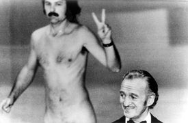 David Niven wasn't quite sure what was happening behind him as a streaker crossed the stage, 1974.