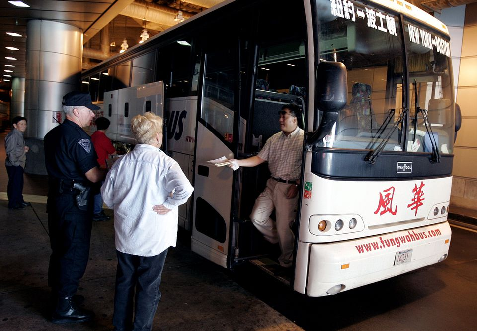 A Fung Wah driver passed his paperwork to state officials during an inspection at South Station in 2005.
