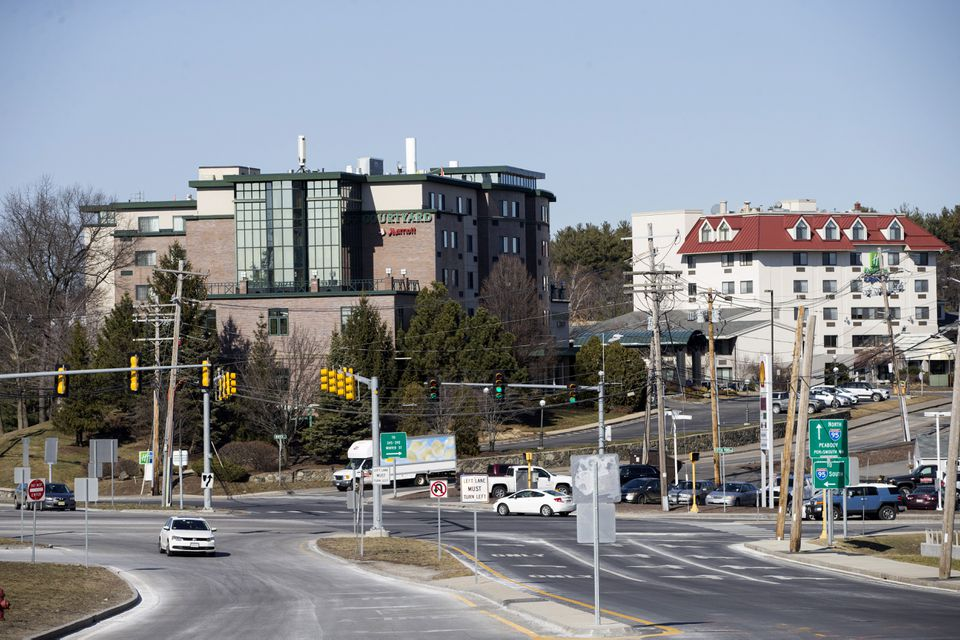 Traffic moves along in front of Marriott Courtyard and Holiday Inn Express hotels in Waltham.