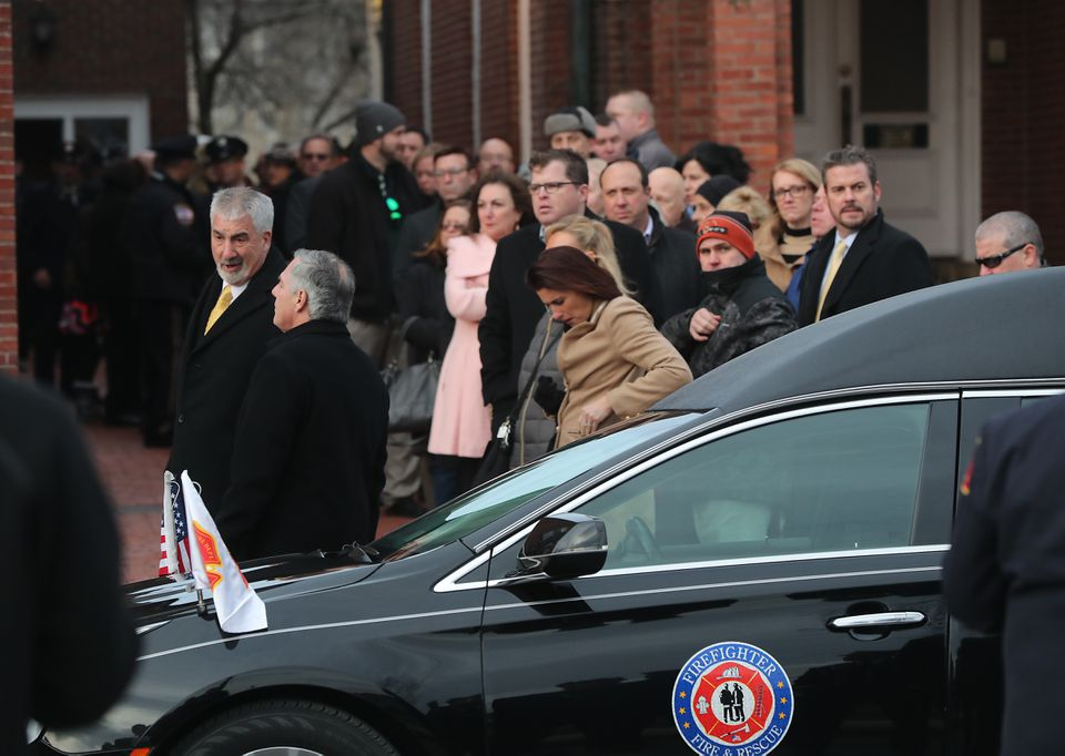 A procession of mourners gathered at the church.