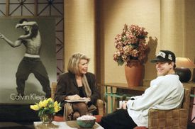 """Rap star Marky Mark, right, reacts to a joke during his appearance on the """"Joan Rivers Show"""" in New York Wednesday, Dec. 2, 1992. Mark unveiled one of the Calvin Klein underwear ads, background, that feature him wearing little but the product. (AP Photo/Bebeto Matthews) -- 19wahlside"""