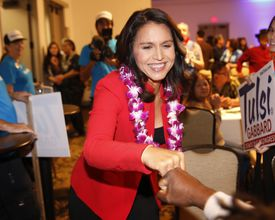US Representative Tulsi Gabbard, a Hawaii Democract, greets supporters, Nov. 6, in Honolulu. Gabbard visited New Hampshire this week, reportedly testing a run for president.