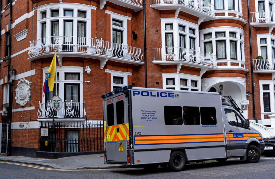 A police van is pictured outside of the Embassy of Ecuador in London on Thursday.
