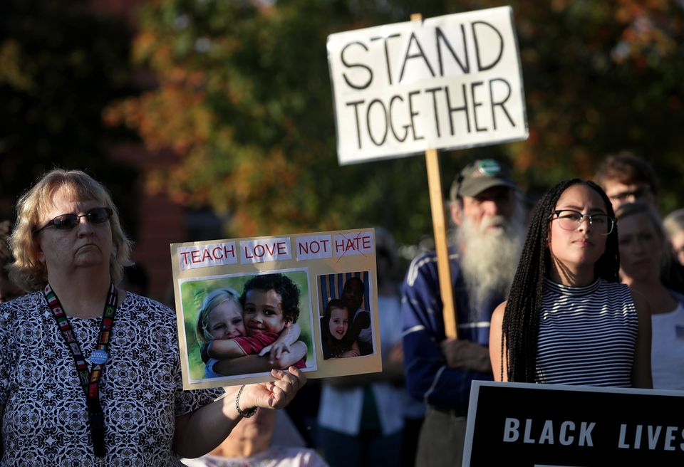 Scores of people gathered Tuesday to show support for the family of an 8-year-old biracial boy who, according to his family, was taunted with racial slurs and hanged from a picnic table.
