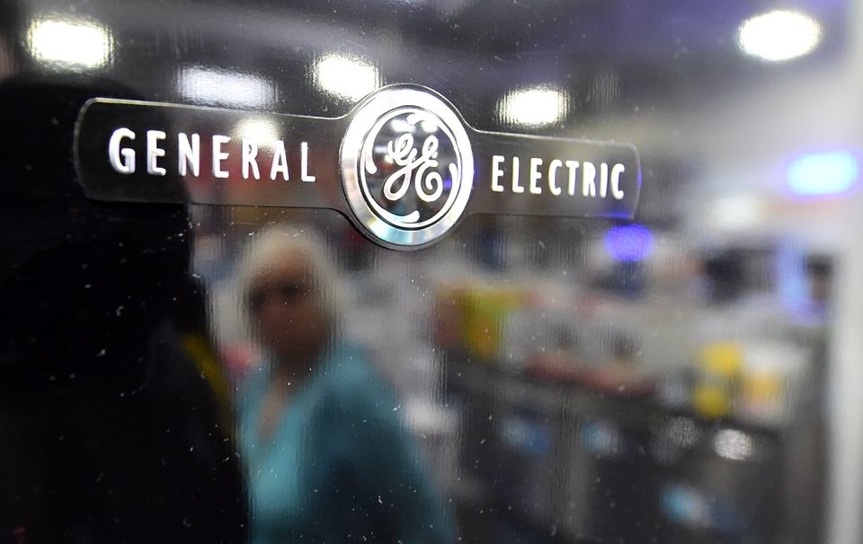 A woman was reflected on the door of a General Electric refrigerator in California.