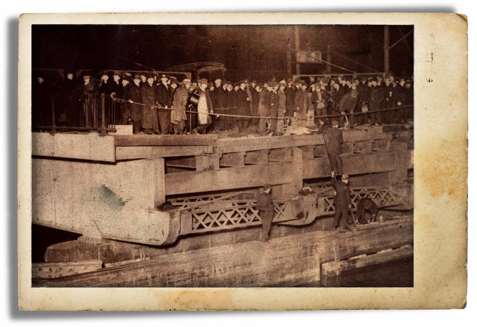 With downtown Boston crowded with rush hour commuters and people who had come out to watch the election results, a massive crowd quickly gathered around the accident scene at Fort Point Channel. This view shows the inbound deck of the open drawbridge that Car 393 had plunged from.