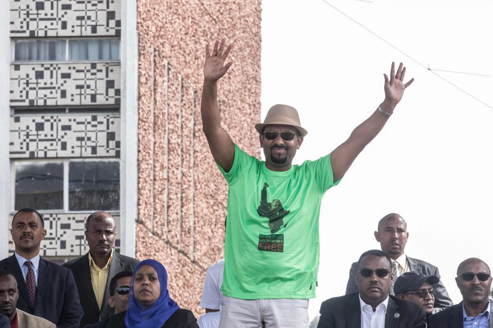 Prime Minister Abiy Ahmed of Ethiopia waves to the crowd during a rally in Addis Ababa on June 23, 2018.