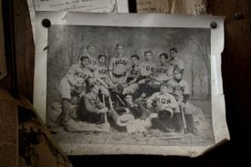 A photo of Ives (front right, with arm resting on tree stump) and his baseball teammates, circa 1890.
