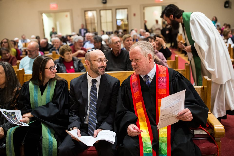 Rabbi David Lerner (center) of Temple Emunah joined Rev. Paul Shupe (right) and Reverend Claire Feingold Thoryn (left) during an interfaith service in Lexington.