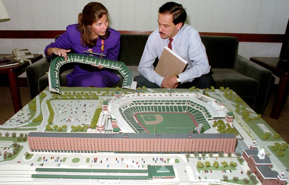 Janet Marie Smith and Larry Lucchino sit in front of a model of what would become Oriole Park at Camden Yards.
