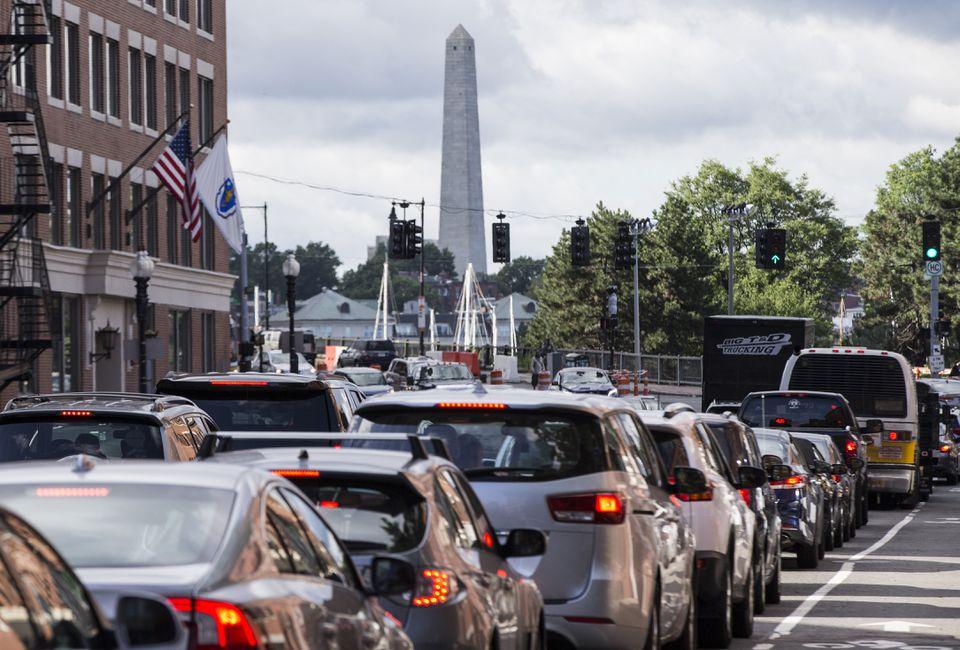 Vehicles make their way through traffic along Washington Street in Boston, July 2017.
