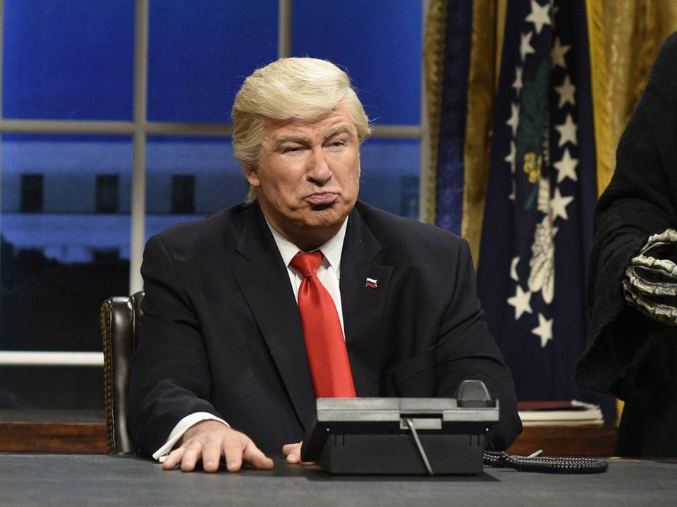 """Alec Baldwin, pictured in a Feb. 2017 opening sketch of """"Saturday Night Live,"""" returns to the late-night show Saturday to mock the president's national emergency."""