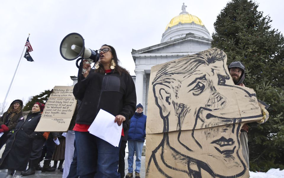 Demonstrators gathered on the steps of the State House in Montpelier on Dec. 18 for a rally in favor of single-payer health care, following Governor Peter Shumlin's decision to pull the plug on Vermont's single-payer plan.
