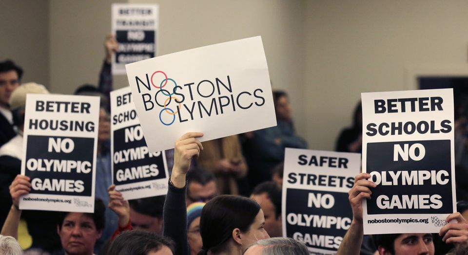 People held up placards against the Olympic Games coming to Boston during a public forum in February.