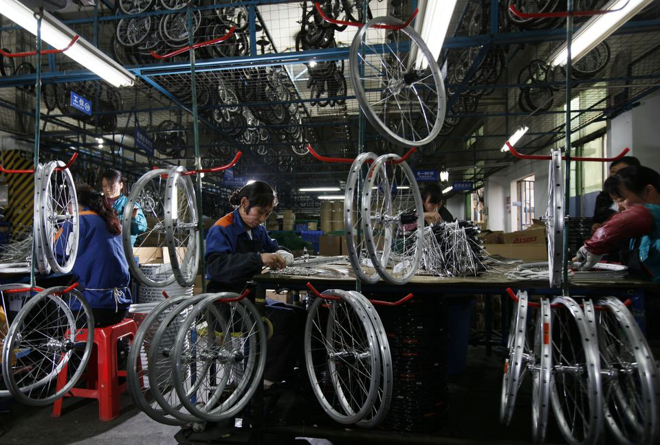 Workers assembled bicycle wheels in Shenzen, China.