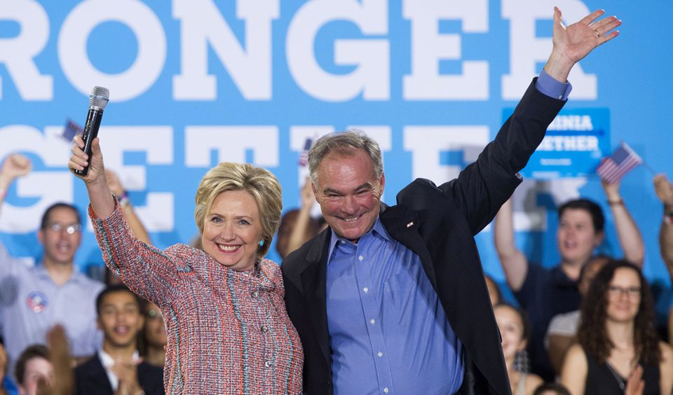 US Democratic presidential candidate Hillary Clinton and US Senator Tim Kaine, Democrat of Virginia, waved during a campaign rally on July 14.