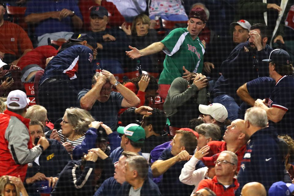 Fans react after Devon Travis lost control of the bat and it flew into the stands.