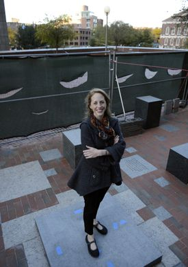Sculptor Ann Hirsch stands at the site where her statue of Celtic legend Bill Russell will be unveiled Nov. 1.