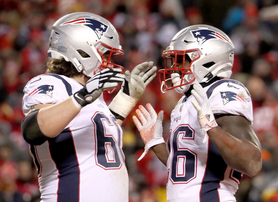 Center David Andrews (left) helped rookie Sony Michel rush for 113 yards.