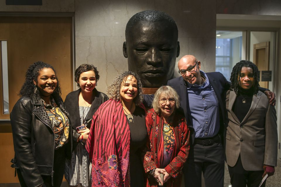 From left to right: Jaclyn, Maya, Erica, Julia, Roy, and Zachary Wilson posed for a portrait in front of the bronze sculpture of Martin Luther King Jr. after an unveiling ceremony at Brookline Town Hall Sunday evening.