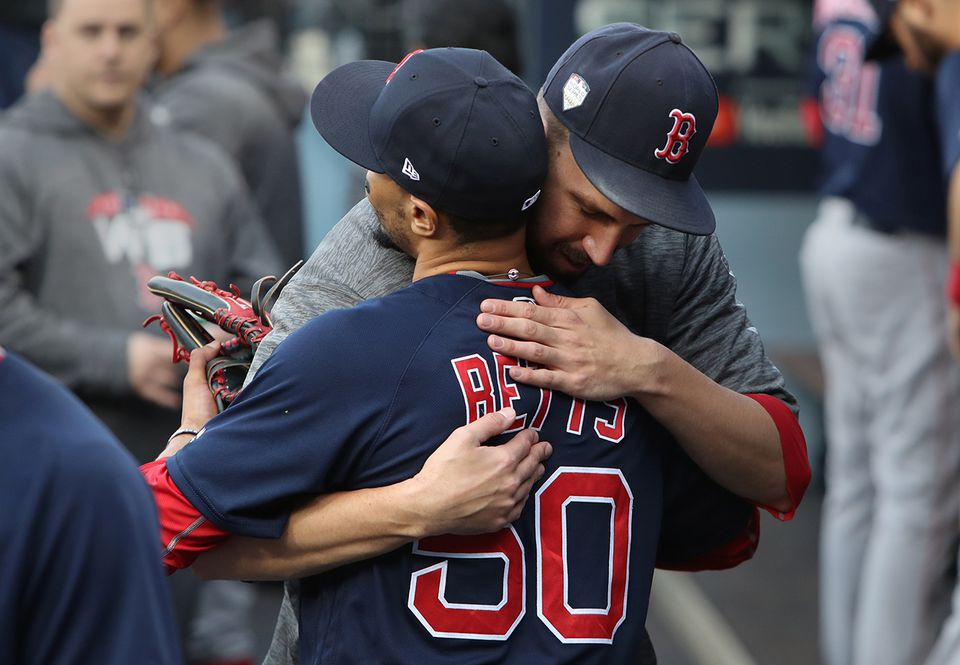 Mookie Betts and Matt Barnes embraced before Game 5 Sunday.