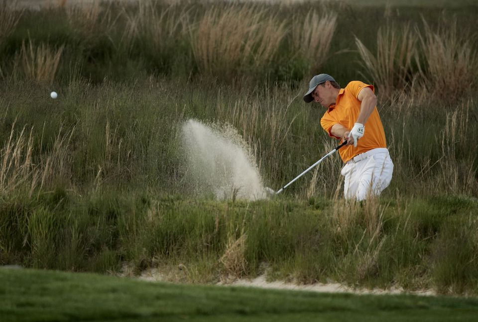 Jordan Spieth hits out of a bunker on the 18th hole during Thursday's first round.